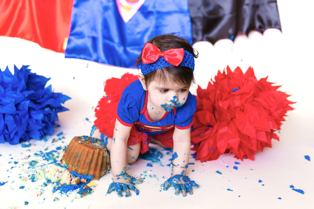 Baby girl crawling away from her smashed cake. Cakesmash photoshoot in Calgary, Alberta. Calgary and Airdrie photographer - Milashka Photography.