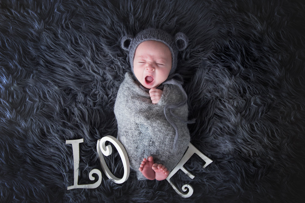 Newborn baby boy yawning. Love letters with little feet. Calgary Newborn Photographer. Milashka Photographer