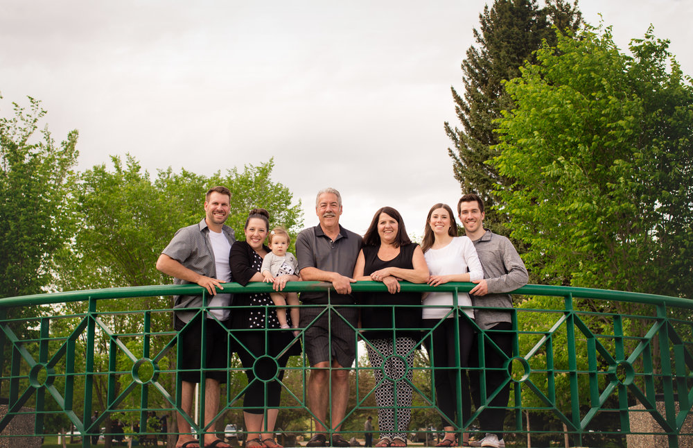 Family of 7 by the rails at Baker's park, Calgary, Alberta. Calgary photographer. Milashka photography