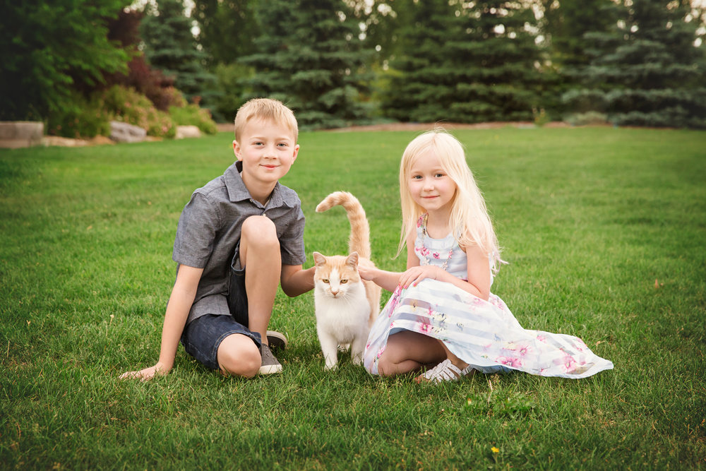 A boy and a girl with a cat. Calgary photographer. Milashka Photography