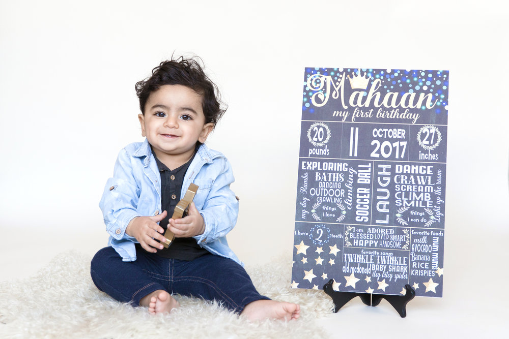 First Birthday board and a birthday boy. Milashka Photography. Calgary Newborn and baby photographer