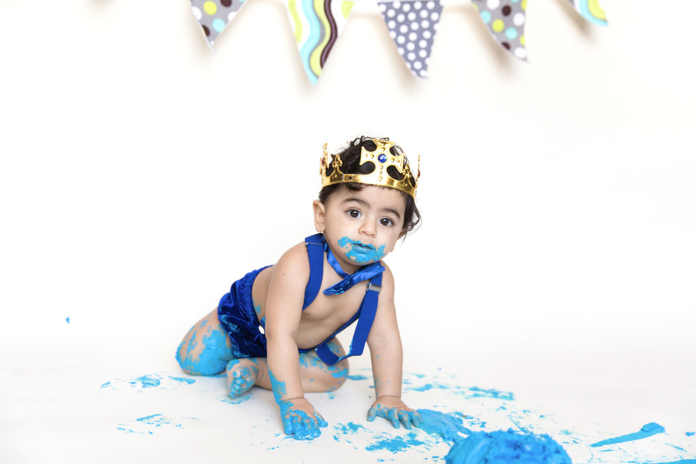 Cakesmash done! Birthday boy is done with his cake. Cakesmash photoshoot. Calgary photographer. Milashka Photography