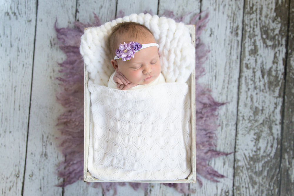 Newborn baby girl in a crate. Calgary newborn photographer. Milashka Photography