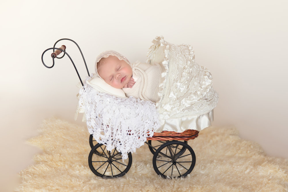 Newborn baby girl in a stroller. Newborn photoshoot in Calgary, Alberta. Calgary newborn photographer. Milashka Photography