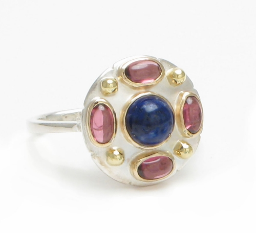 Sodalite and garnet ring set in 14k gold and silver. Size 7.  $340 on sale