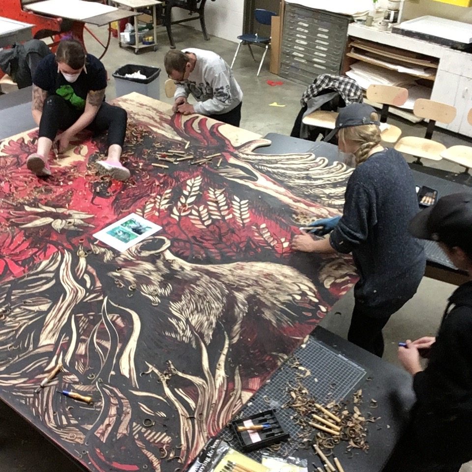 Mykel Vanek, Gilbert Sumerland, Kendra VanderBerg and Jacok Miller hand carving the pieces.