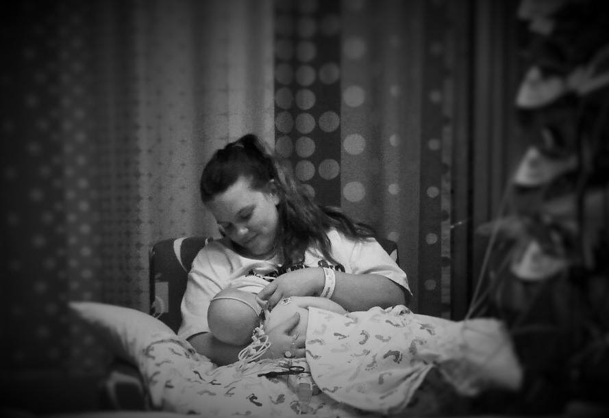 The first time nursing my son again after his heart attack at 3 months old. Although not perfect, it's a photo I'll cherish forever.  Click here for his story.