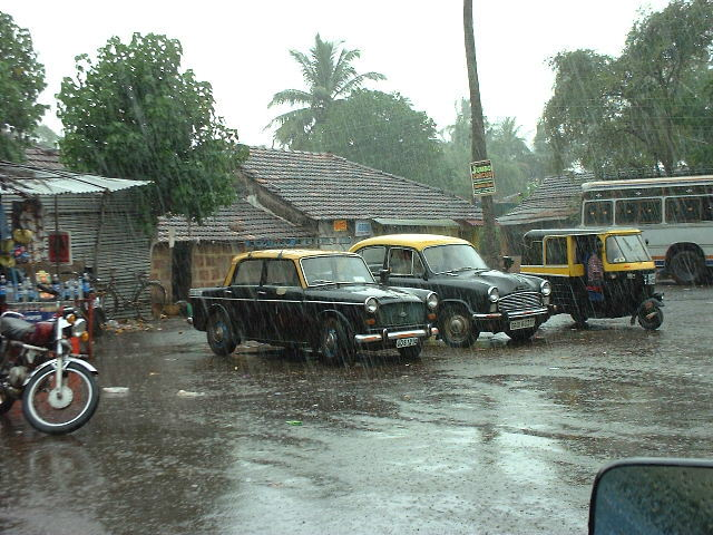 Goan taxis in the rain. The brilliant Ambassador (a living 1954 Morris Oxford) is in the middle