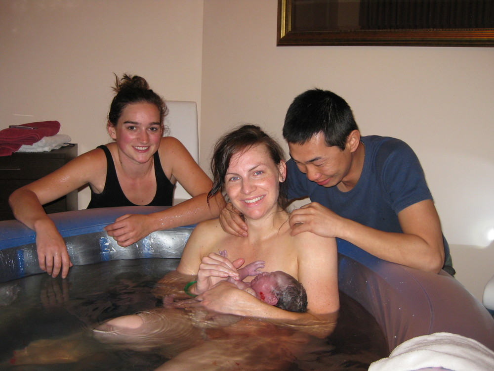 Favourite pic; the new family plus our midwife Hannah