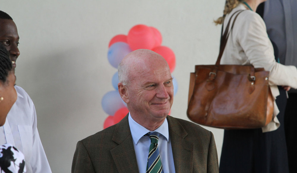 Roeland van der Geer, EU Head of Delegation to Tanzania, gestures as he is taken around the CAC buildings before the commencement of the CAC Dedication Ceremony. Joining him were the Tumaini University Makumira Student Organization President and Vice - President.