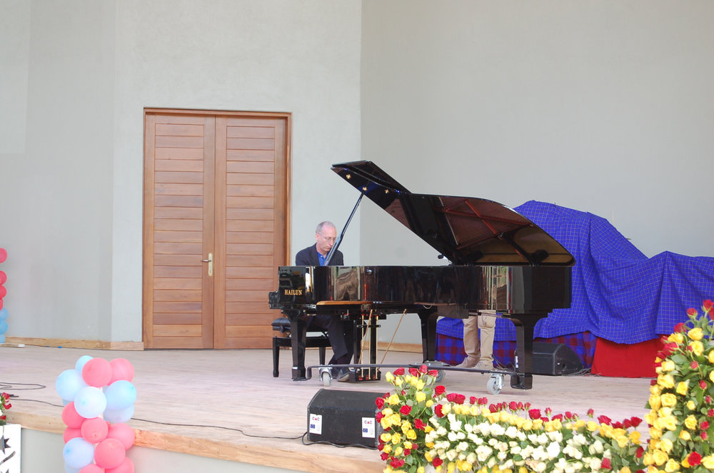 Randy Stubbs, CAC Programme Manager, plays the concert grand piano during the CAC Dedication Ceremony. This grand piano was generously donated by friends in the United States of America under coordination of Dr. Abe Caceres of World House Music, North Carolina. It is probably the third grand piano at a university in Africa.