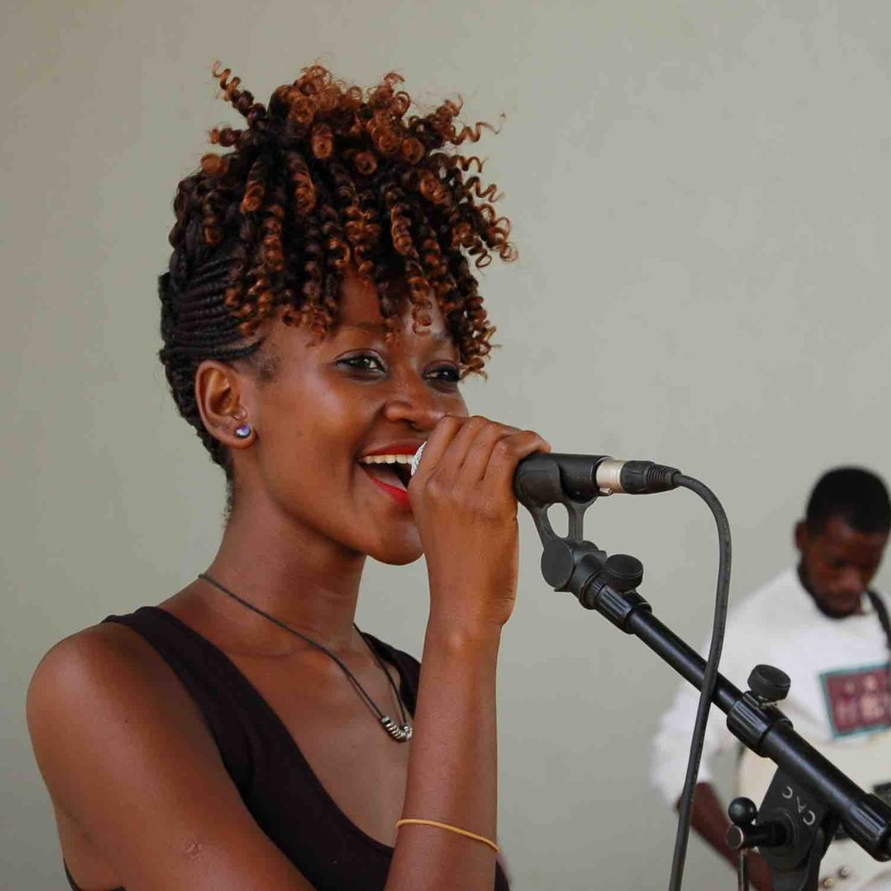 FATINA MWASHA - Fatina began at the Kilimanjaro Wizard Group. She has acted with the Chinganga Arts Group. She studied at the Komboa Association Centre. She sings lead and backing vocals for the CAC fusion. The highlight of her career has been performing at DoaDoa performing arts fest.