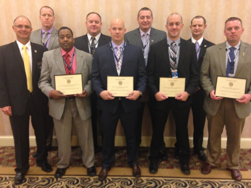 "Shown above are Major Case Squad Investigators who received ""Certificates of Merit"" at the 2016 re-trainer.  The awards were presented to the investigators for their outstanding investigative skills and talents during the Shiloh, Illinois homicide investigation into the death of Kenneth J. Easley on June 27, 2015.  The investigators were nominated by Captain James Cavins and Sergeant Rob Thomason.  Pictured Left to Right beginning in the back row: ·         Investigator John Wayne (SIUE PD) ·         Special Agent Patrick McGuire (Illinois State Police) ·         Sergeant Jesse Phillips (Shiloh PD) ·         Sergeant Rob Thomason (Belleville PD)- Deputy Report Officer Front Row: ·         Captain James Cavins (O'Fallon IL-PD)- Deputy Commander ·         Sergeant Maurice McMiller (St. Clair Co. Sheriff's Dept.) ·         Detective Jared Lambert (Mascoutah PD) ·         Detective Brian Schreiber (Fairview Heights PD) ·         Detective William Barlock (O'Fallon IL-PD)"