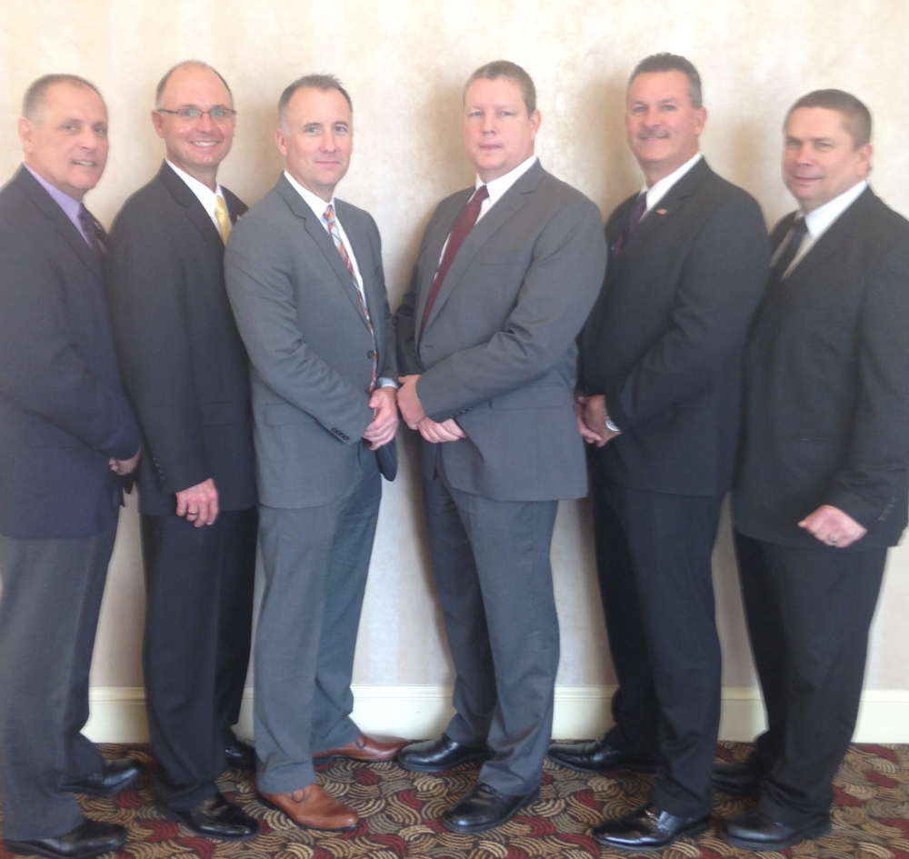 "Shown above are previous recipients of the ""Major Case Squad-Robert G. Lowery Sr. Award for Investigative Excellence.""  Pictured Left to Right are: ·         Captain Dan DeCarli (Ferguson PD) - Commander of the Major Case Squad of Greater St. Louis ·         Captain James Cavins (O'Fallon IL-PD) - Deputy Commander, 2014 award recipient ·         Major Tim Fagan (Florissant PD)- Deputy Commander, 2016 award recipient ·         Captain Randy Boden (Florissant PD)- Chief Deputy Commander for the State of Missouri, 2005 award recipient ·         Major Jeff Connor (Madison County IL Sheriff's Dept)- Chief Deputy Commander for the State of Illinois, 2012 award recipient ·         Chief Tim Lowery (Florissant PD)- Executive Board Member, son of Robert G. Lowery Sr."