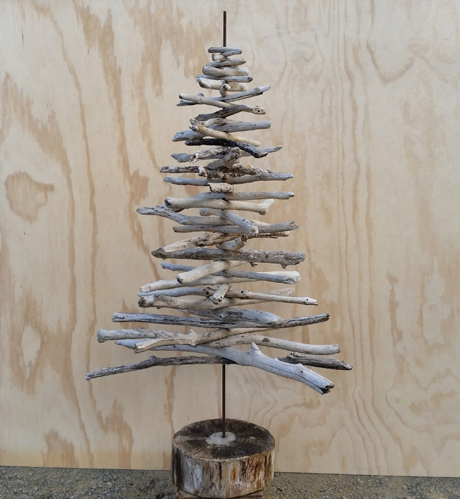 scissorsandthread: Driftwood Christmas Tree | Frk Hansen I've seen driftwood trees like this for sale at the stores for over $200! Why pay that when you can get the wood for free? This tree is perfect for spaces that can't take a huge pine or for those of you who want something simple that you don't need to decorate (though this would look great with seaside or Nordic inspired Christmas tree decorations!)