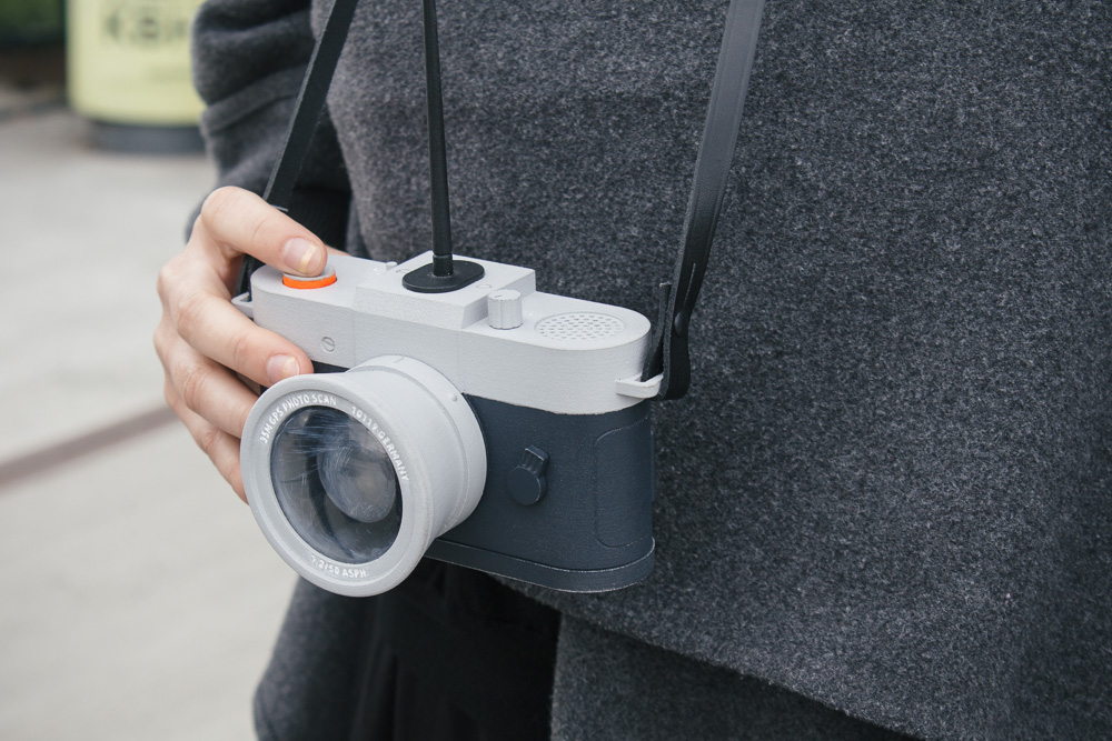 The camera features a rectractable shutter, antenna and a speaker.