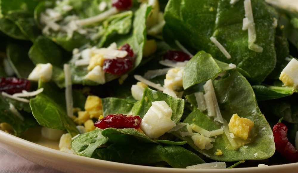 Spinach Salad with Eggs Protein-filled, wallet-friendly eggs make this salad a hit.