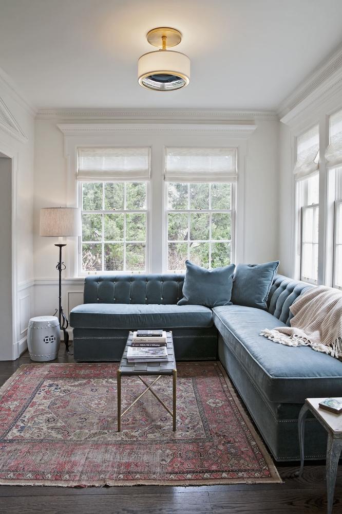 Blue tufted velvet banquette sofas in a cozy corner. Rachel Halvorson Inspired Decorating Tips. #bluevelvet #banquette #slateblue