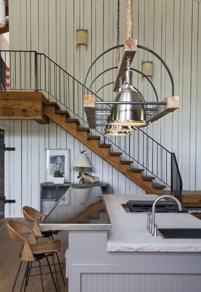 Rustic modern farmhouse kitchen with staircase and industrial pendant over island. Rachel Halvorson Inspired Decorating Tips. #modernfarmhouse #kitchen #industrial #barnwood