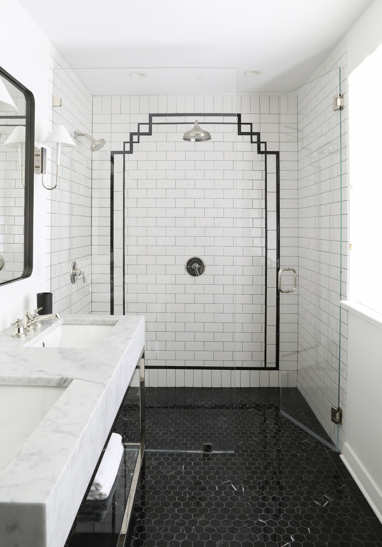 Classic bathroom with black and white. White subway tile and black decorative accent. Marble topped console sink, and black tiled floor. Rachel Halvorson Inspired Decorating Tips. #blackandwhite #bathroom #classic #walkinshower #subwaytile