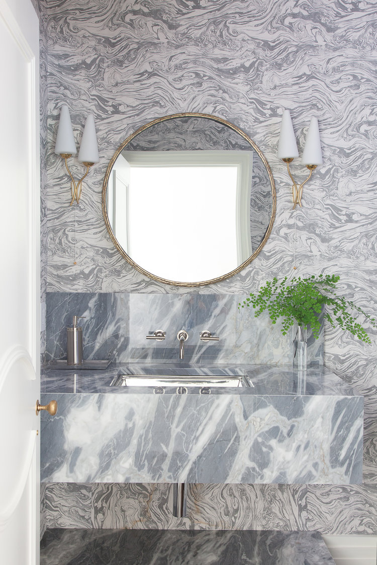 Grey marble pattern wallpaper in luxurious bathroom with marble console sink and gold accents. Rachel Halvorson Inspired Decorating Tips. #marble #grey #bathroom #gold #wallpaper