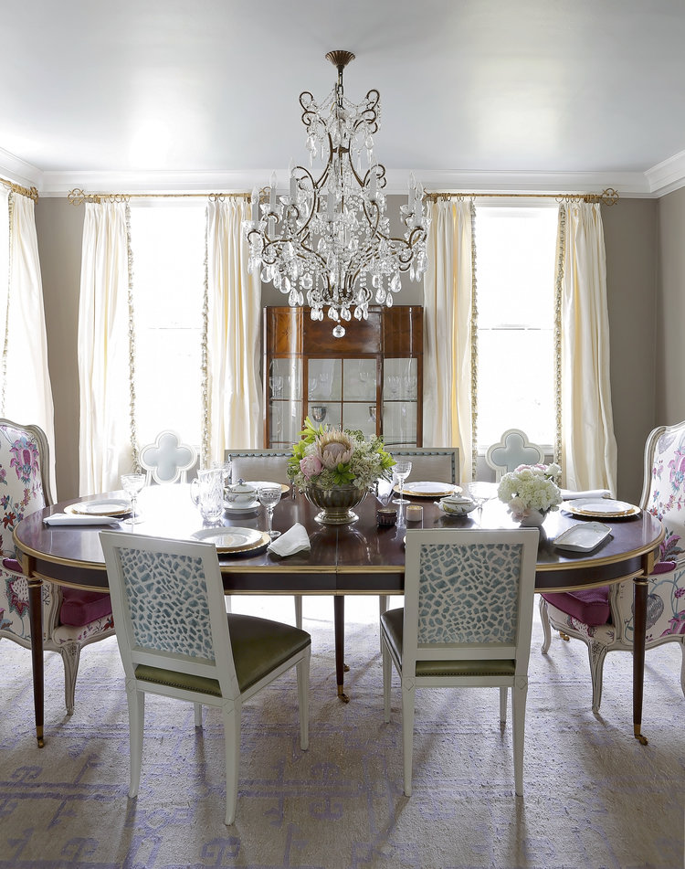 Classic dining room with oval table and mixed dining chairs upholstered in bold prints. Rachel Halvorson Inspired Decorating Tips. #diningroom #traditional #oval