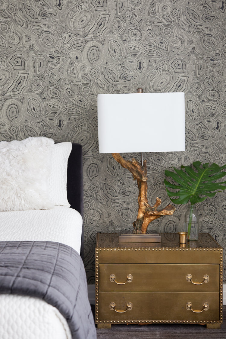 Dramatic grey abstract wallpaper in bedroom with warm gold metallic chest and branch lamp. Rachel Halvorson Inspired Decorating Tips. #bedroom #grey #gold #metallic #wallpaper