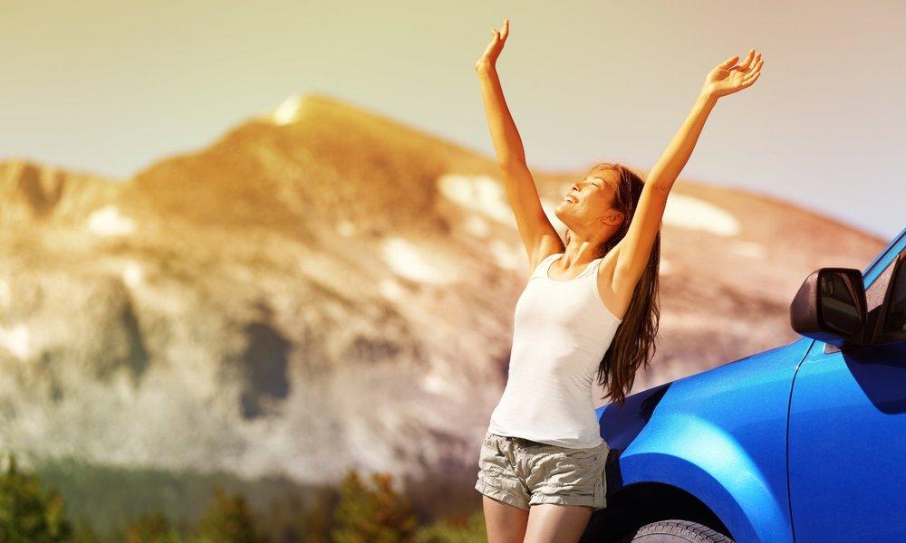 Happy freedom car woman on summer road trip travel