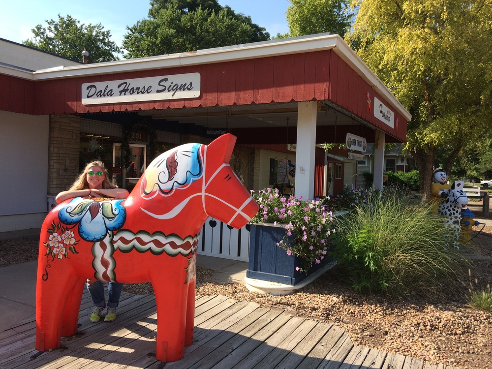 Cortney with her Dala horse in Lindeborg, KS. Not a single soul out on the streets that day!