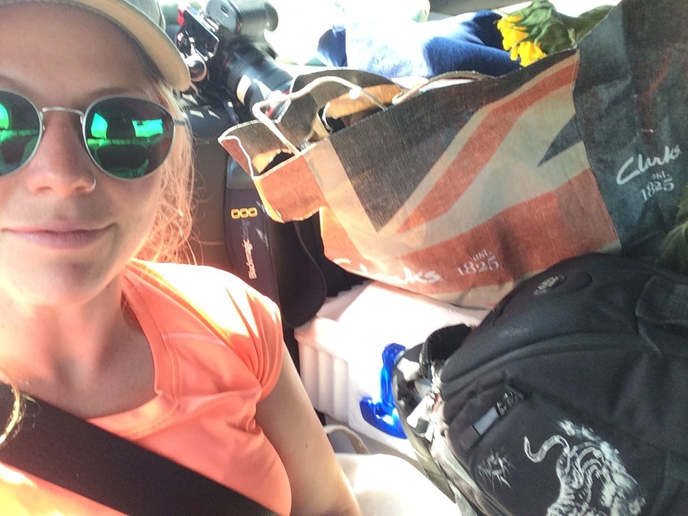 Cortney's back seat selfie of the backseat supplies about to eat her alive.