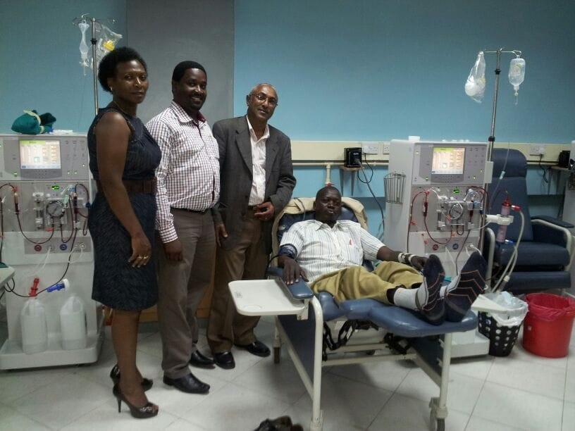 Dr. John Mwaura (second from right) at the dialysis clinic in Kenya where he is the Executive Director, with Medical Consultant Dr. Peter Wachira and Operations Director Ruth Kooro