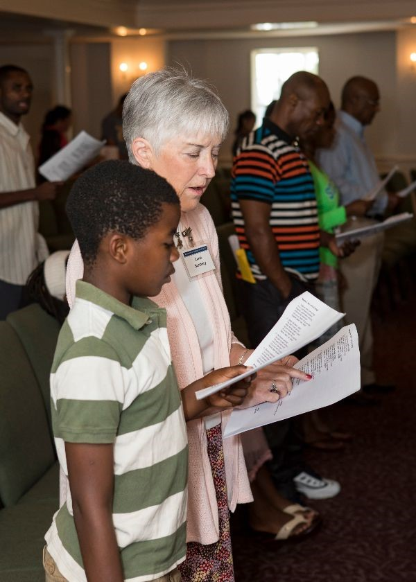 Carol Sunbury and Patrick singing together at a Congolese church service at Westminster Presbyterian Church.