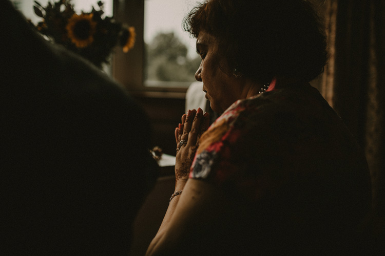 indian mother prays during puja