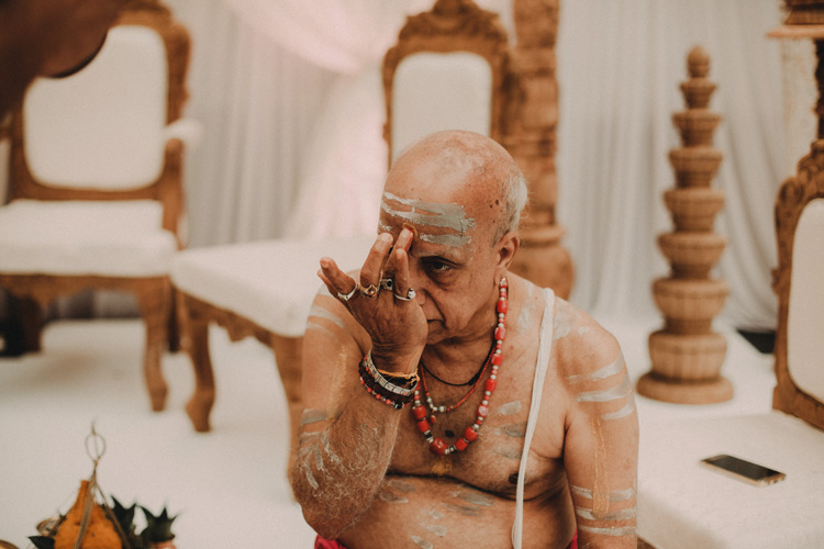 priest prepares himself for hindu ceremony