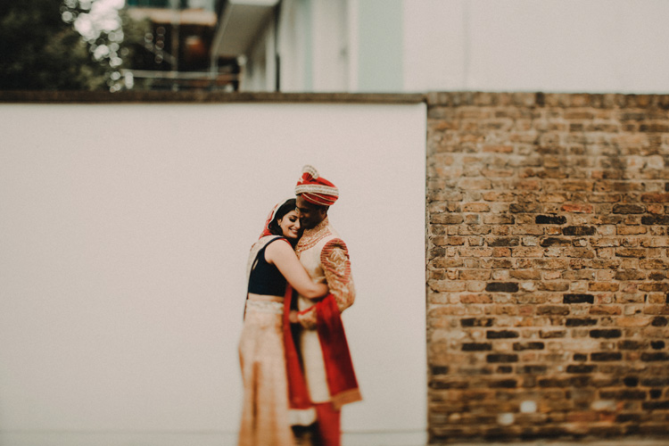 indian couple embrace in the streets of london after hindu ceremony