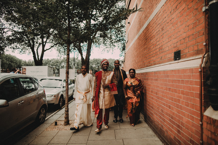 grooms precessional with family to hindu ceremony in london wedding