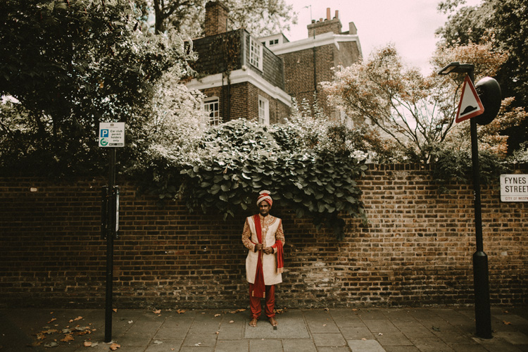 indian groom standing in london streets after hindu ceremony
