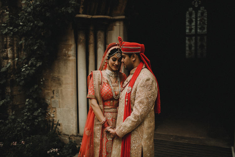 groom holds bride after traditional hindu ceremony