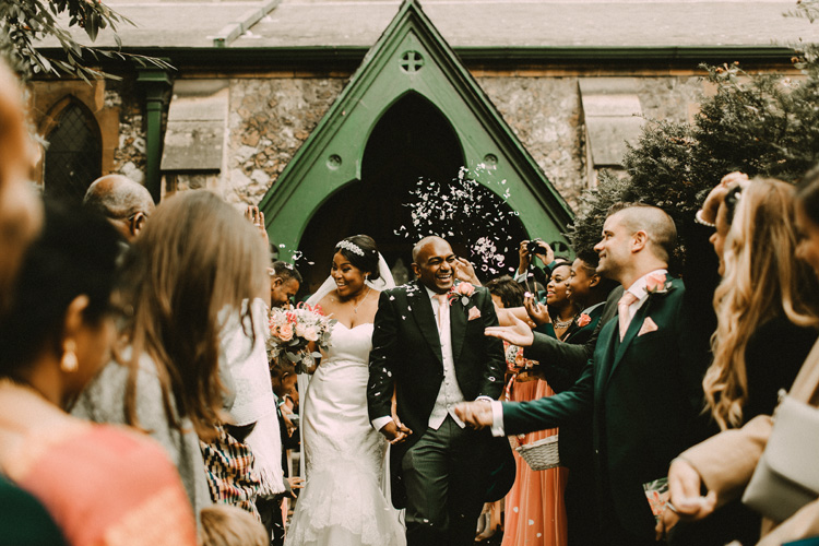 indian groom and african bride leave traditional london wedding
