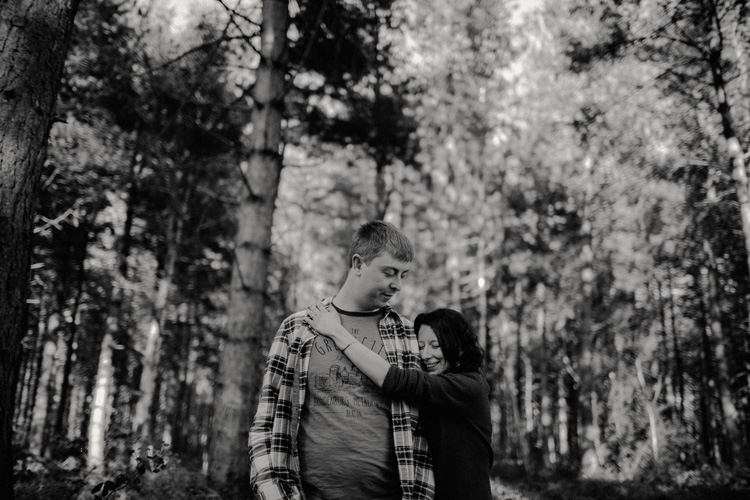 alice hugs sam in birchington forest engagement session