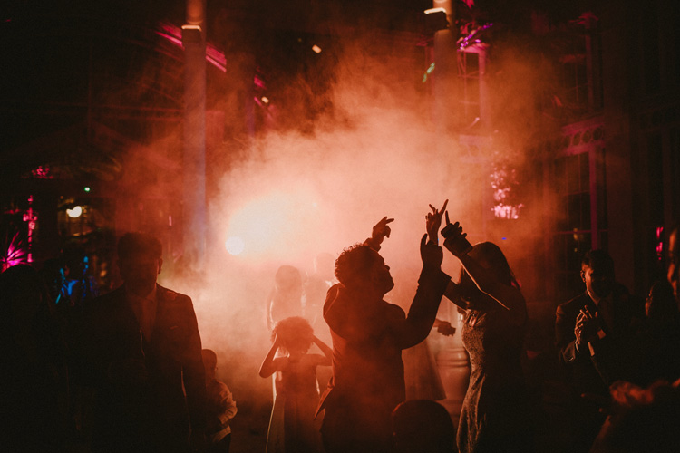 guest dance with smoke machine during syon park wedding reception