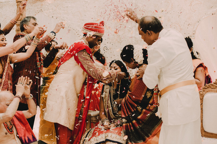 groom gives bride Mangala sutra in hindu ceremony