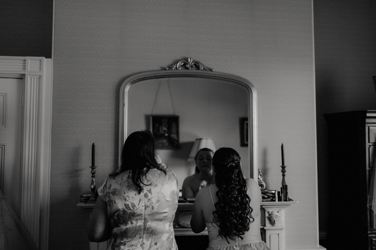 mother and daughter get ready during quex park wedding