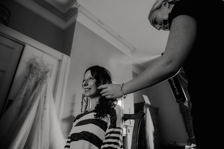 vintage bride getting hair done in quex park wedding
