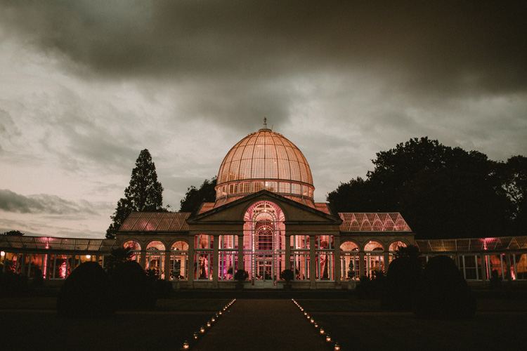 the Great Conservatory lit up in the evening in syon park wedding