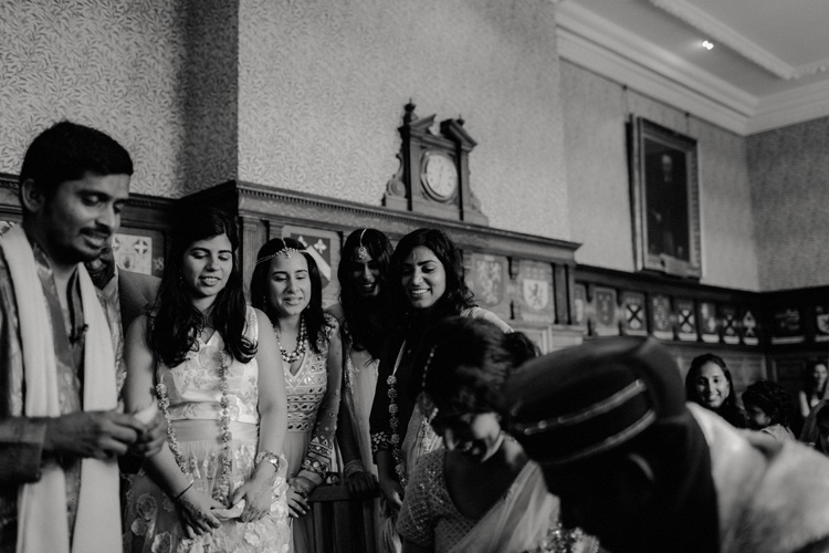 bridesmaid look on during hindu ceremony at the great hall