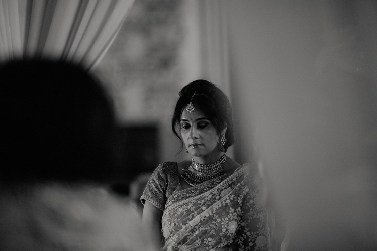brides mother looks on during hindu ceremony at the great hall