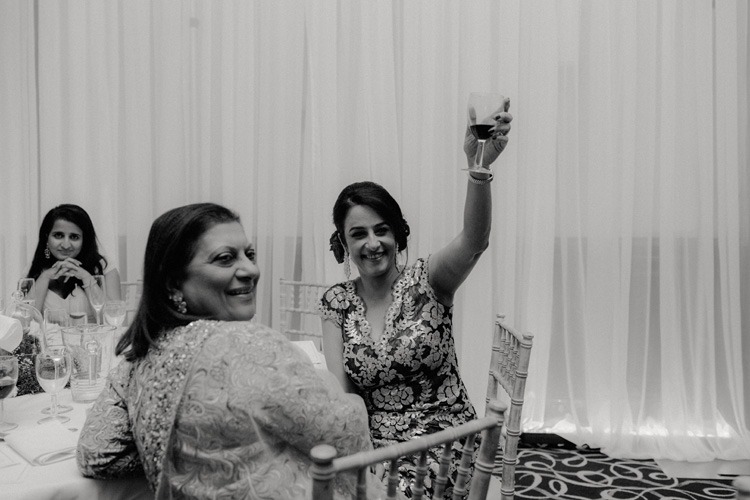 brides mother raises glass after speech during southampton wedding reception