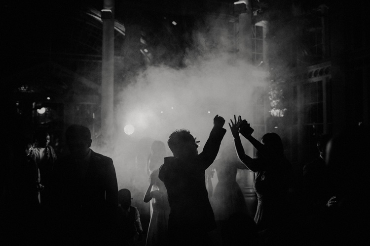 wedding guests dance during wedding reception at syon park