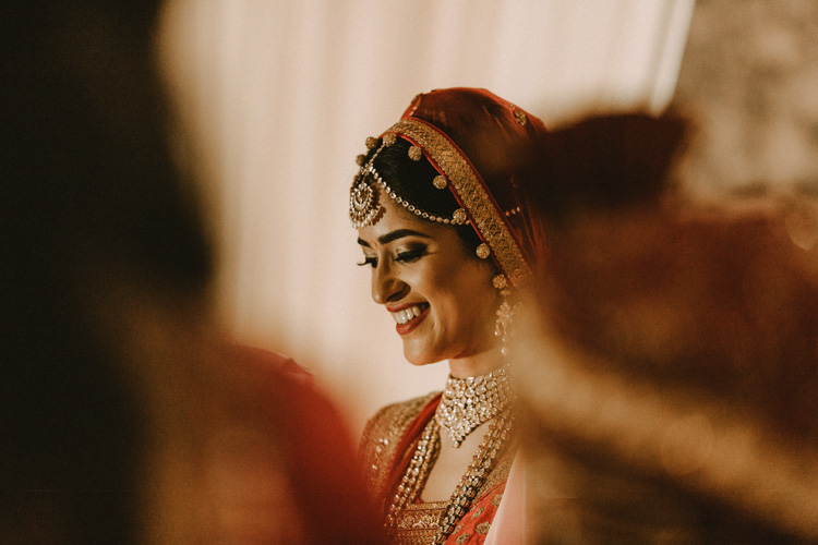 bride smiles during hindu wedding ceremony at the great hall